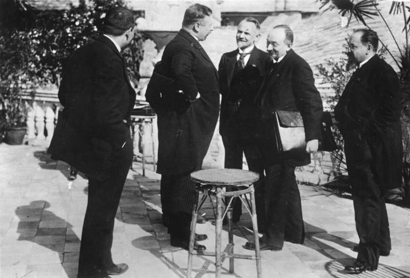 1922: German Chancellor Joseph Wirth (second from left) and Soviet Foreign minister Georgi Chicherin, sign the diplomatic and economic agreement that puts an end to the isolation of the two countries after World War I.